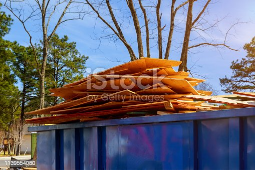 istock Old and used construction material in the new building construction work site. 1139554080