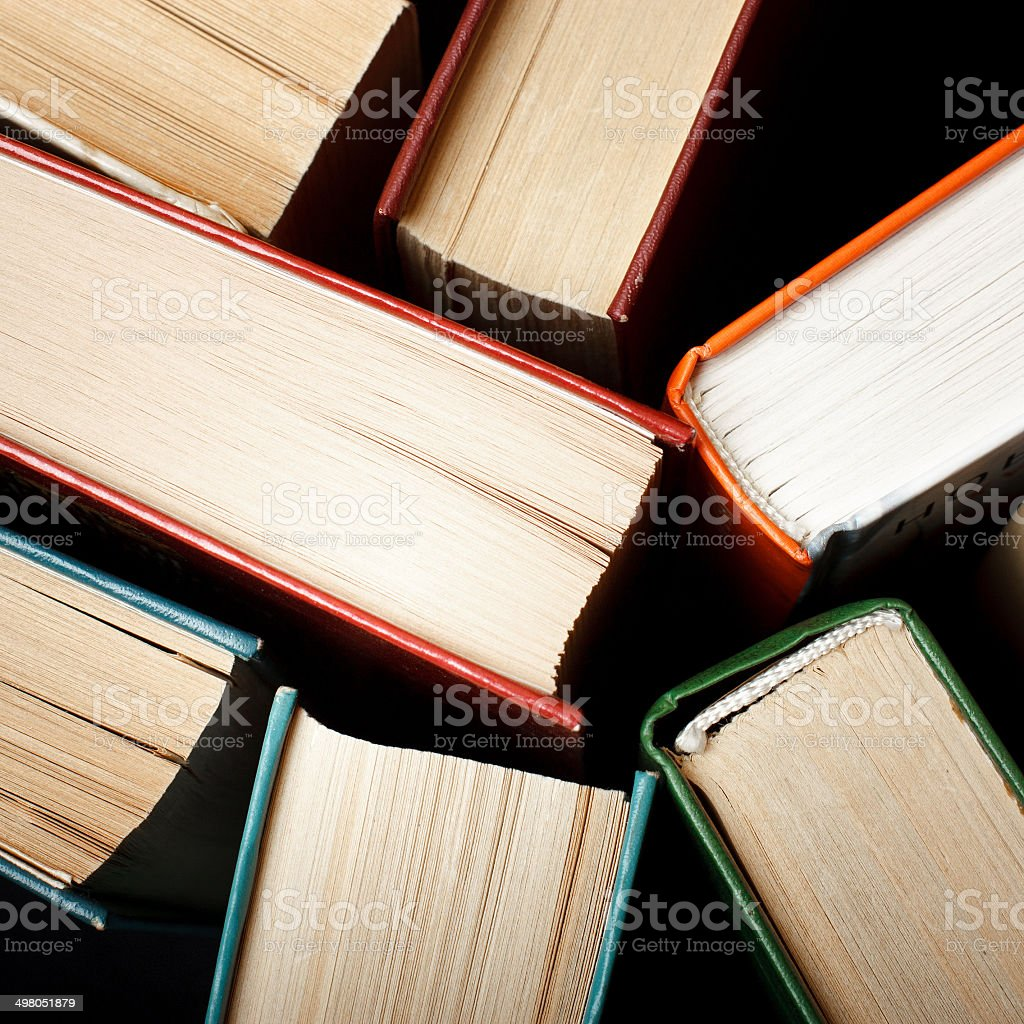 Old and used hardback books or text books seen stock photo