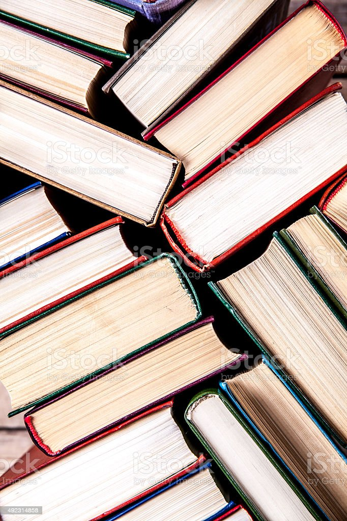 Old and used hardback books stock photo