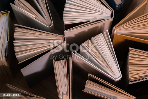 istock Old and used hardback books, text books seen from above on wooden floor. Books and reading are essential for self improvement, gaining knowledge and success in our careers, business and personal lives 1040308390