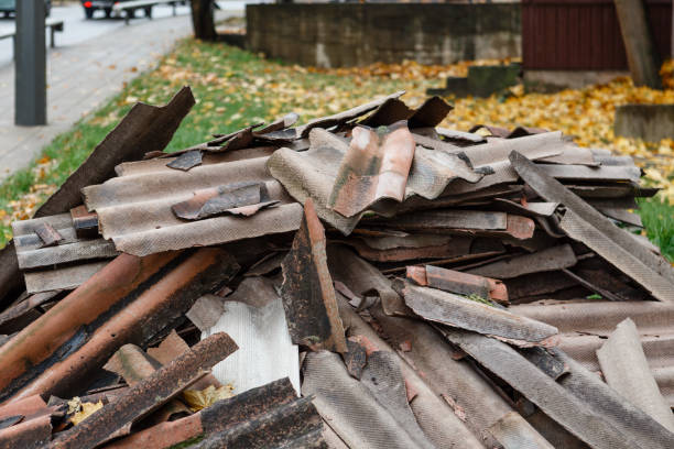 Old and very dangerous asbestos roof. Asbestos dust in the environment. Health problems stock photo