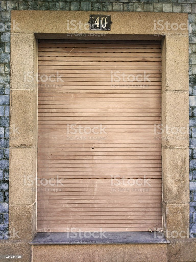 Old And Vintage Closed Window With Wooden Shutter In A