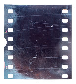 exposed 35mm film material isolated with scratches, grungy film material