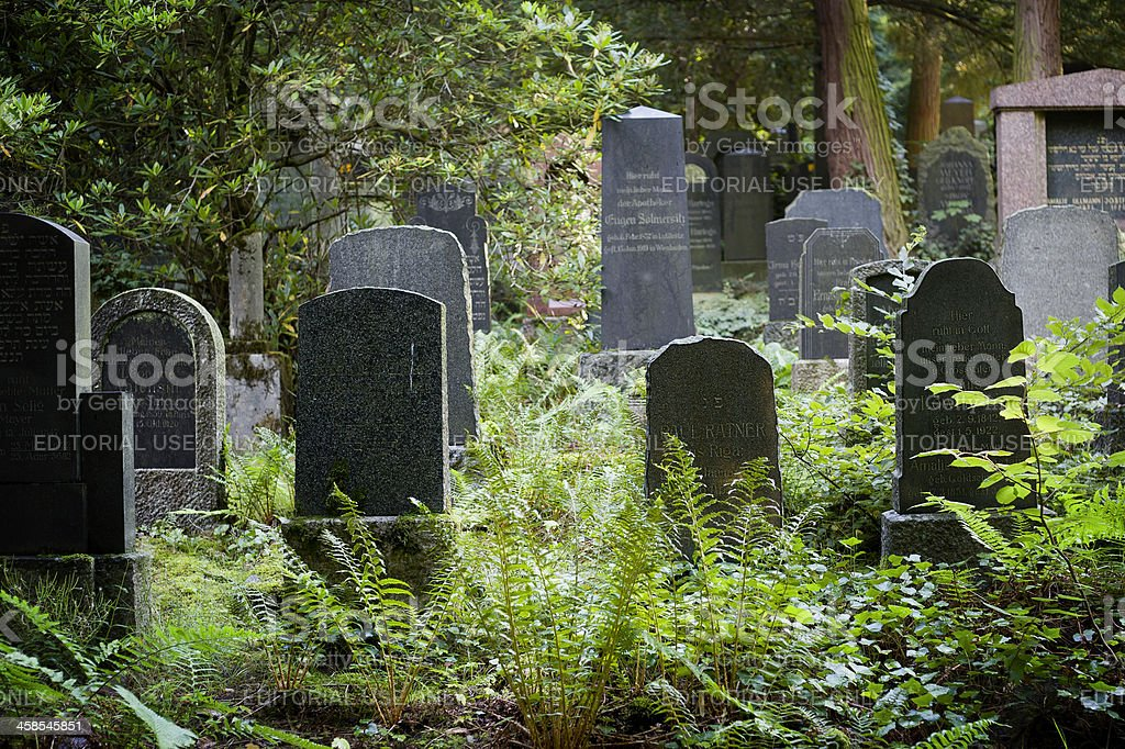 Old and weathered tombstones on jewish cemetery royalty-free stock photo