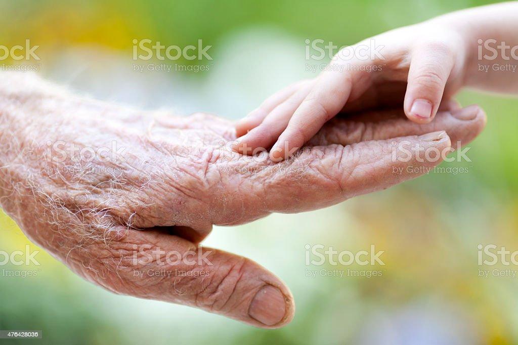 Senior and children hands