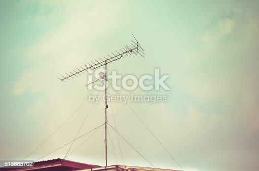 istock Old antenna with blue sky background 513883702