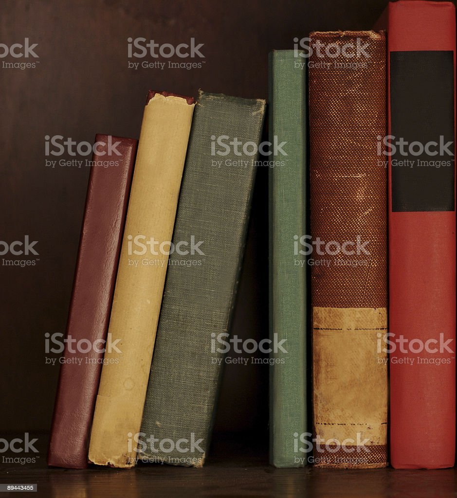 old antique books on a shelf royalty-free stock photo