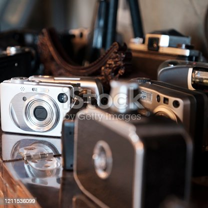 1125303139 istock photo Old antique camera photographed close-up with vintage camera lens 1211536099