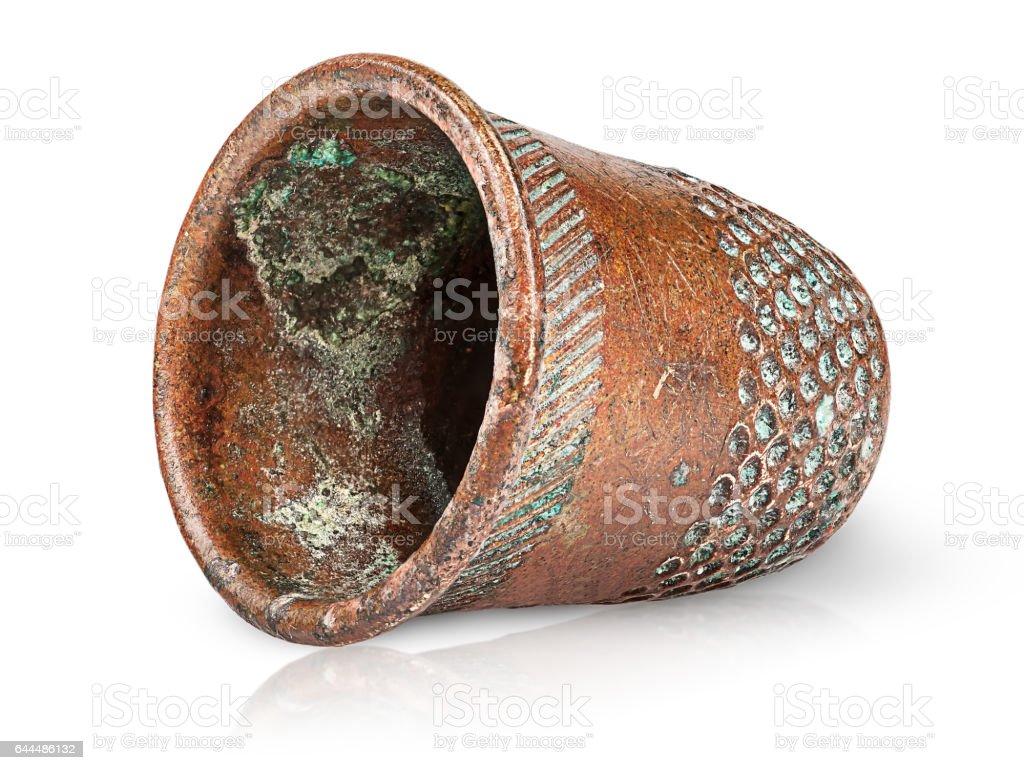 Old antique copper thimble horizontally stock photo