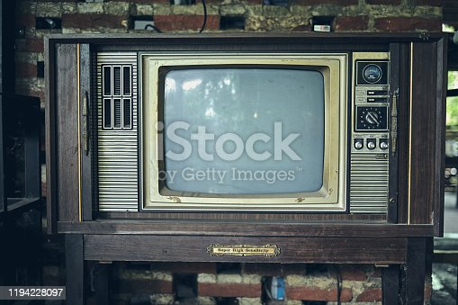 Old antique monochrome television in vintage living room