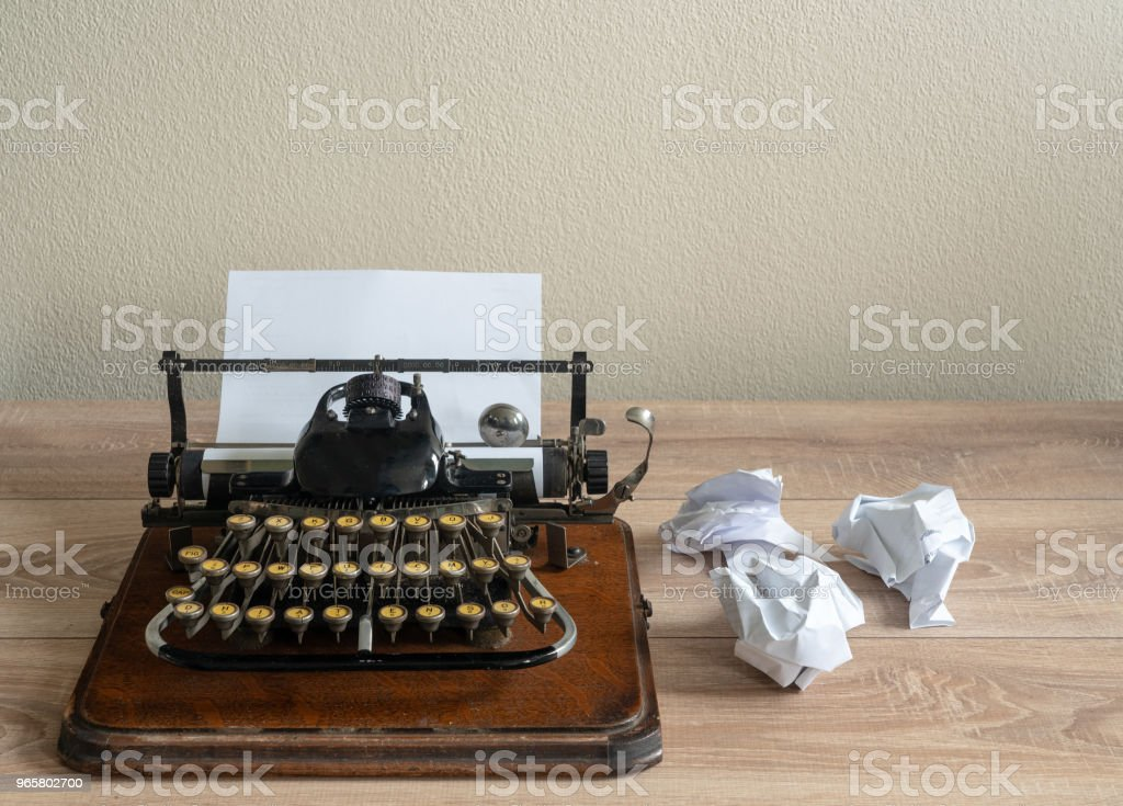 Old antique portable typewriter with screwed up paper on desk - Royalty-free Abandoned Stock Photo