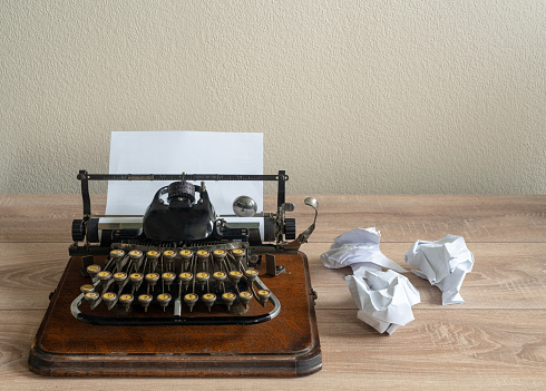Old Antique Portable Typewriter With Screwed Up Paper On Desk Stock Photo - Download Image Now