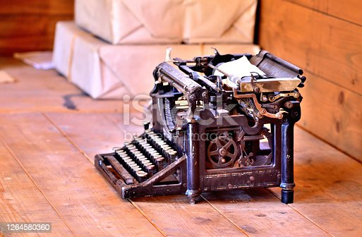 Old antique typewriter from first world war in grunge looks on a wooden table