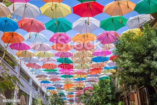 Lefkosa (Nicosia), Cyprus - September 11, 2016: People are spending time at Cafe at Arasta street in a sunny day under the colorfull umbrella.