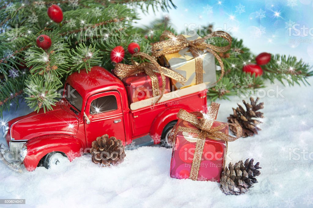 Old Truck With Christmas Tree.Old Antique Toy Truck Carrying A Christmas Gift Box Stock