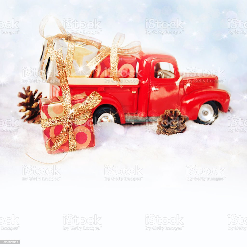 Old Antique Toy Truck Carrying A Christmas Gift Box Royalty Free Stock Photo