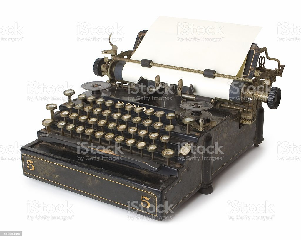A old antique typewriter with blank paper royalty-free stock photo