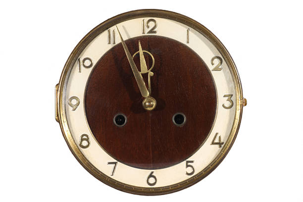 Old antique wall clock isolated on white