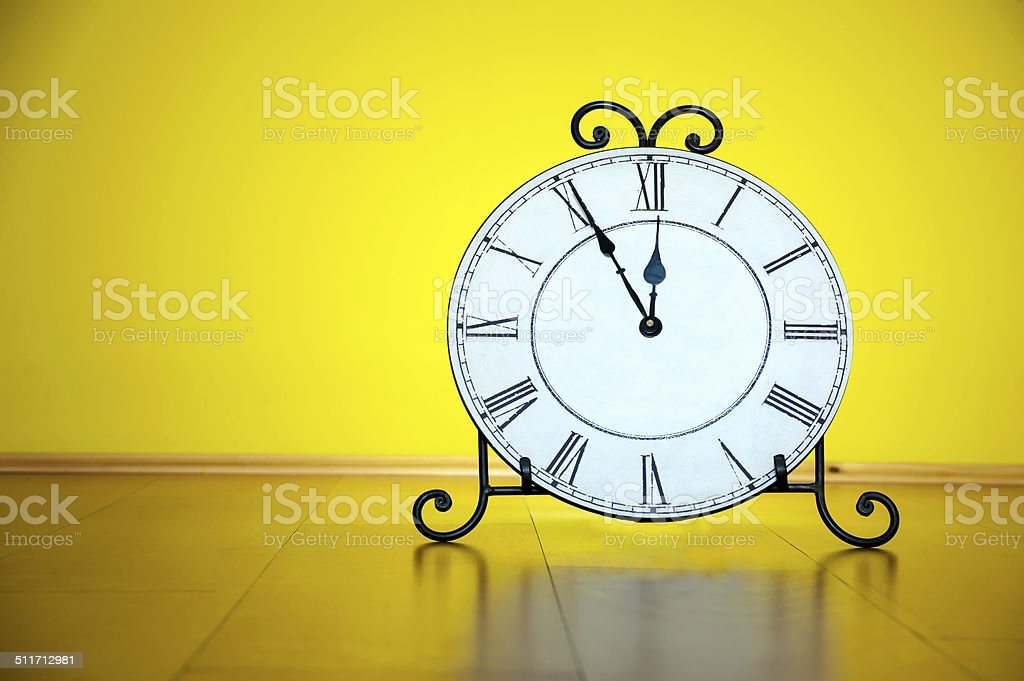 Old antique wall clock isolated stock photo