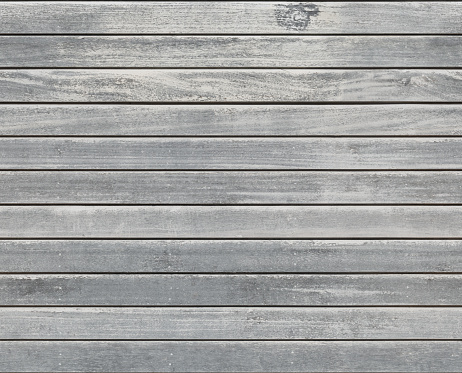 A full frame, seamlessly tiling wooden board texture made from the siding of a very old farm house.