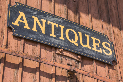 Old antiques sign