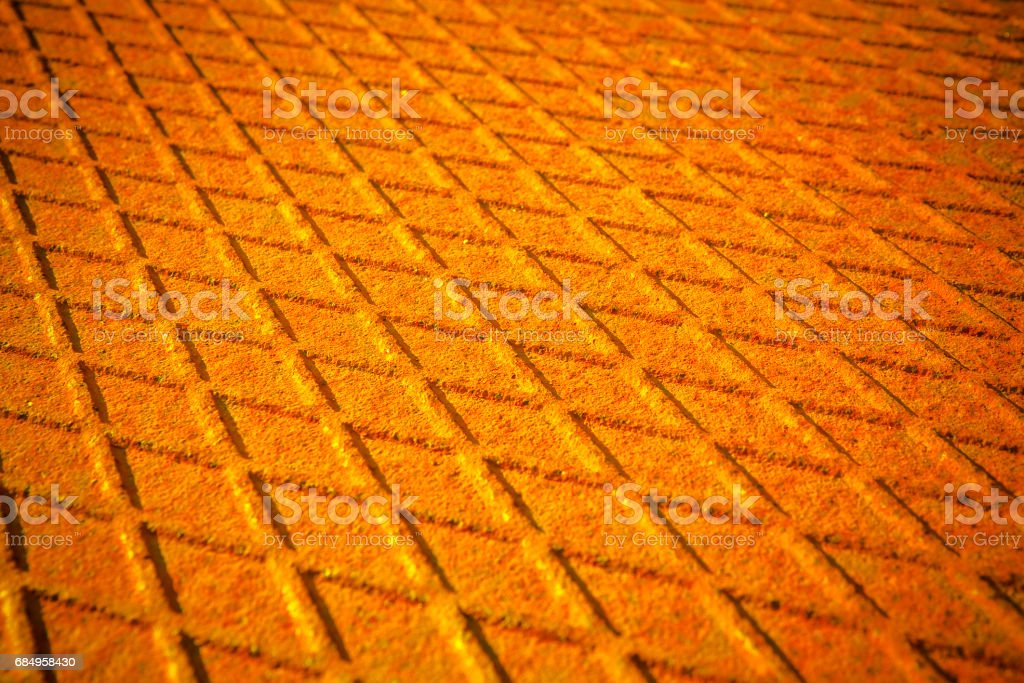 Old antislip corrugated and rusty metal plate - toned image stock photo