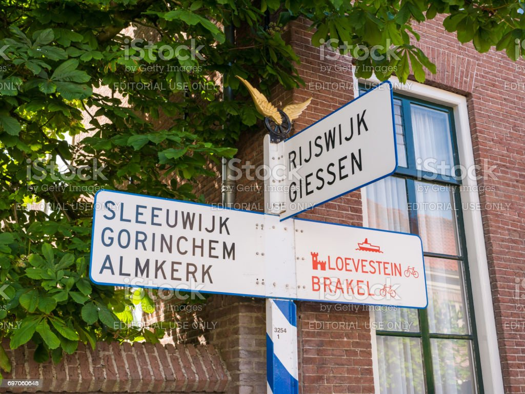 Old ANWB signpost in Woudrichem, Netherlands stock photo