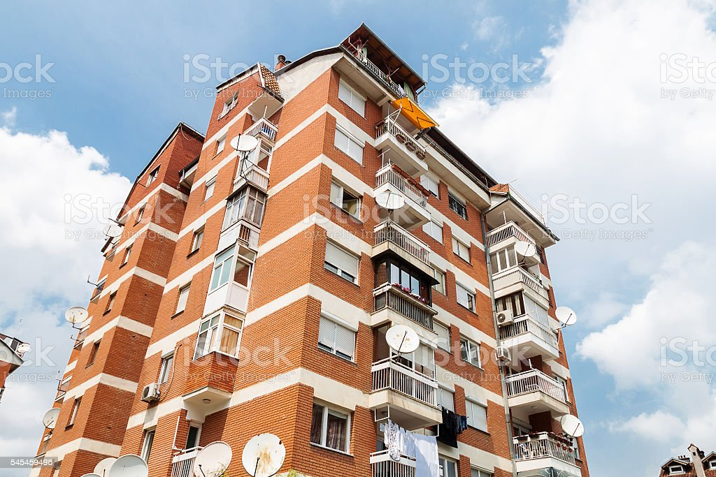 old apartement block with red bricks stock photo