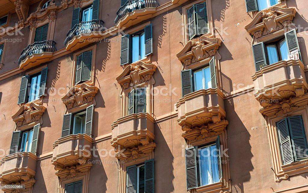 Old apartment building in Rome, Italy stock photo