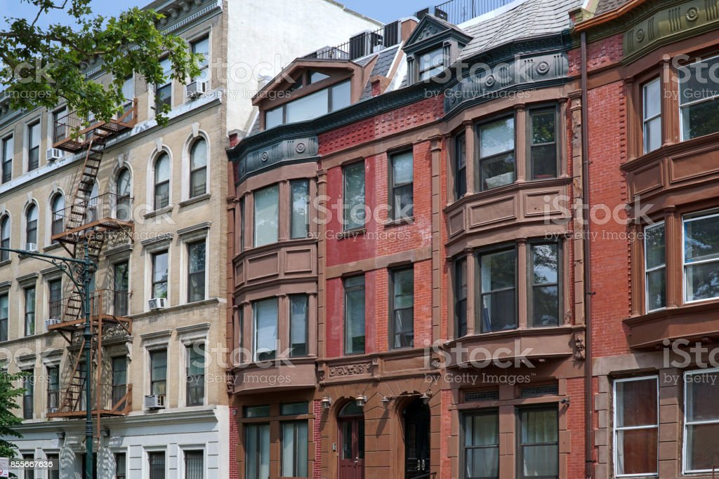 old apartment building with external fire escape stock photo