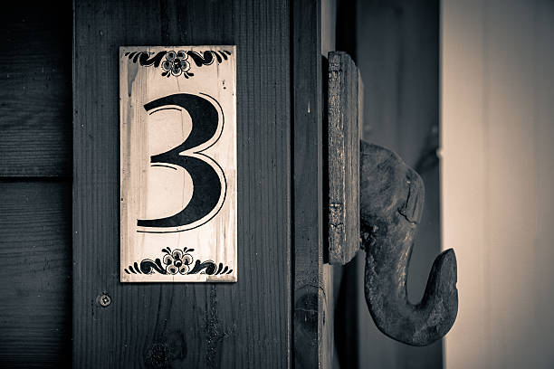 Old apartment number sign stock photo