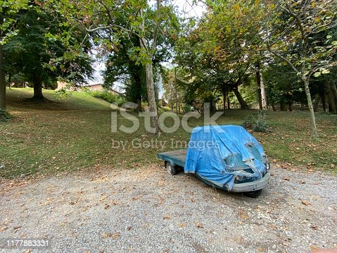 Old Ape Piaggio Abandoned in a Park