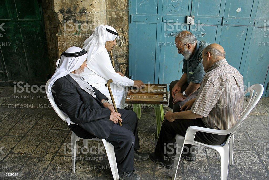 old arab men playing backgammon stock photo