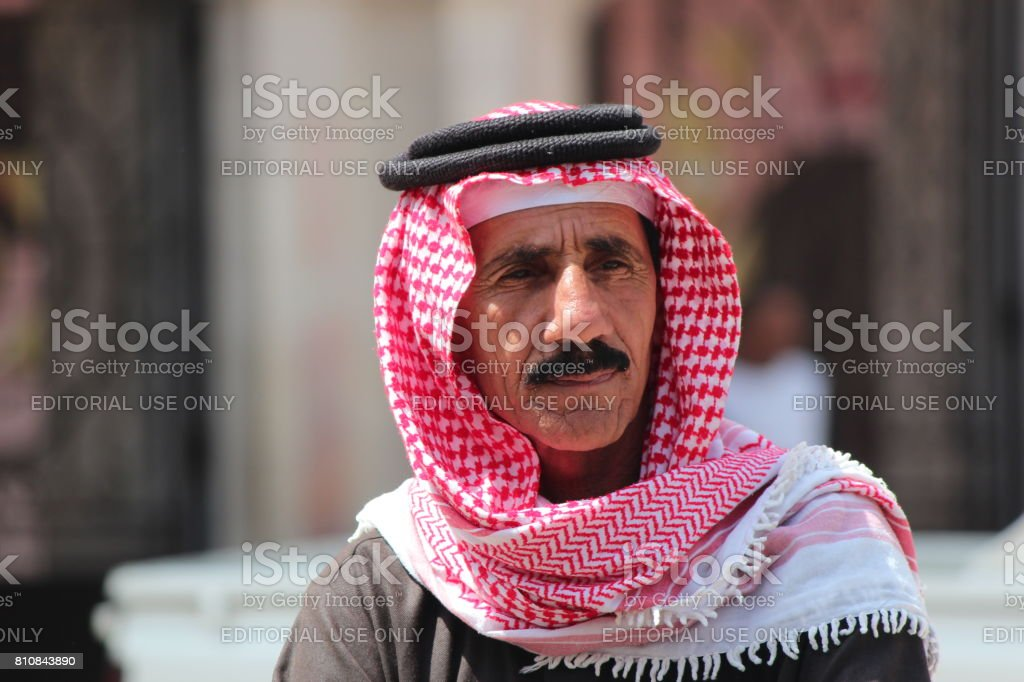 Old arabic man in in the streets of Amma, Jordan stock photo