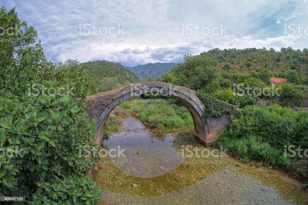 Old Arch Stone Bridge, Montenegro stock photo