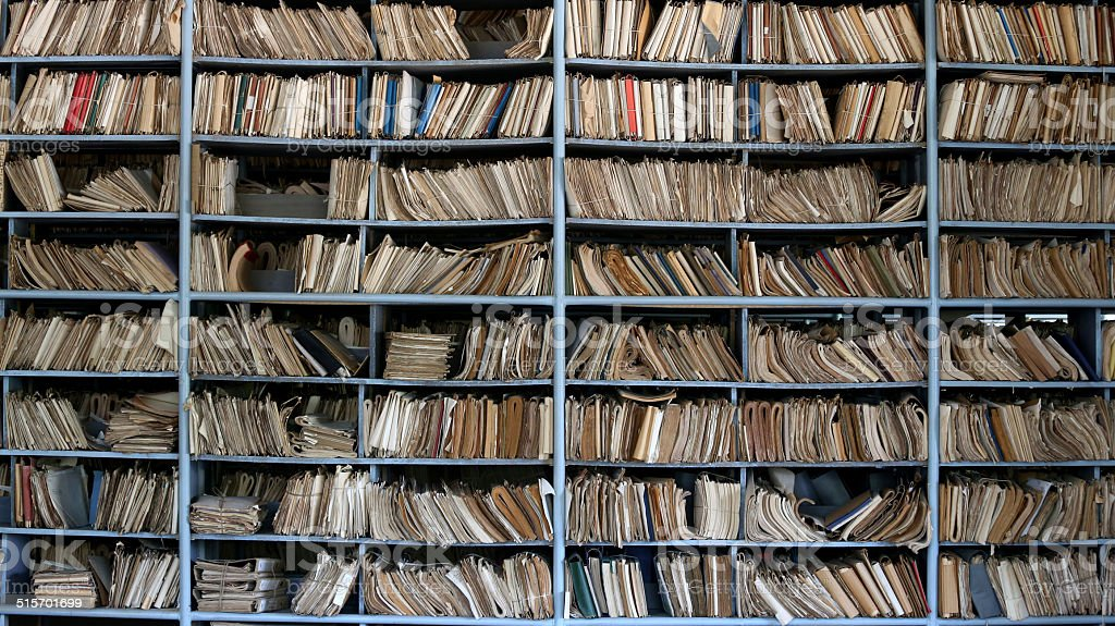 Old archive Shelves full of files in a messy old-fashioned archive Archives Stock Photo