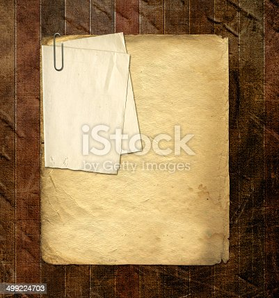 istock Old archive with letters, photos on  abstract grunge background 499224703