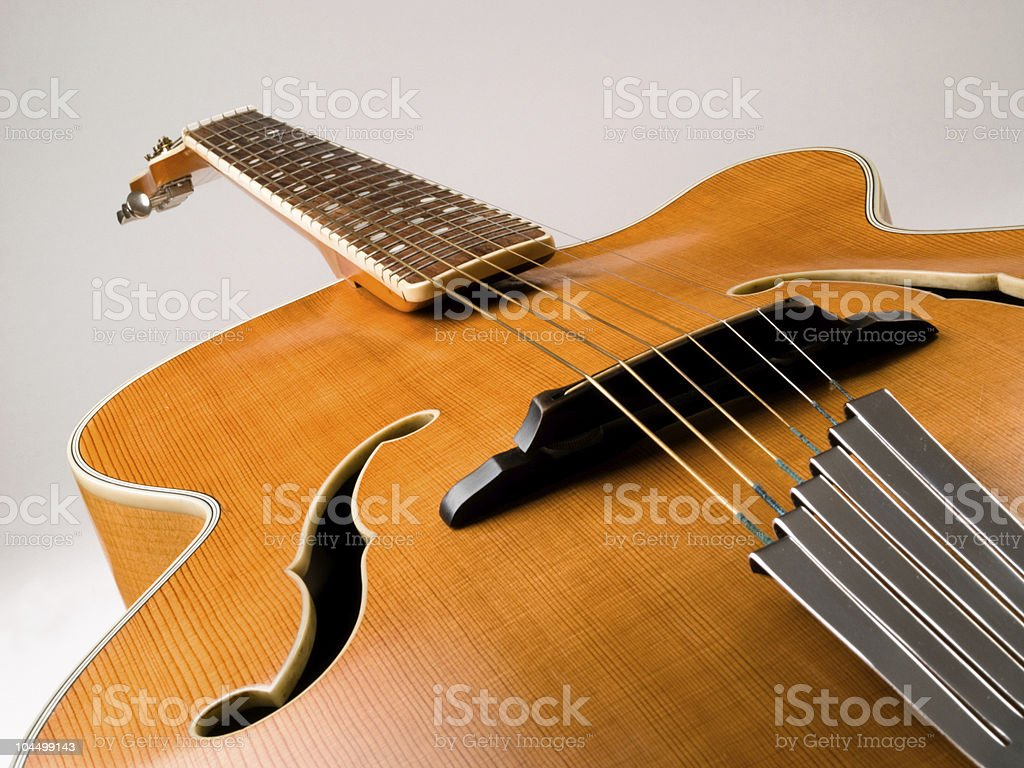 Old archtop jazz guitar stock photo