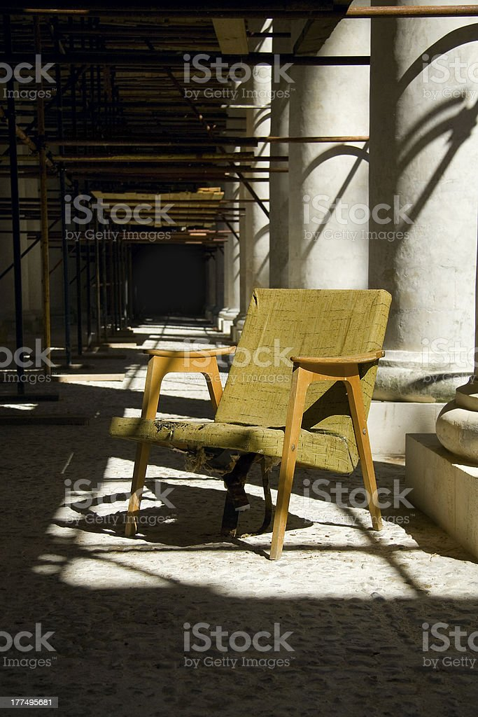 old armchair among columns royalty-free stock photo