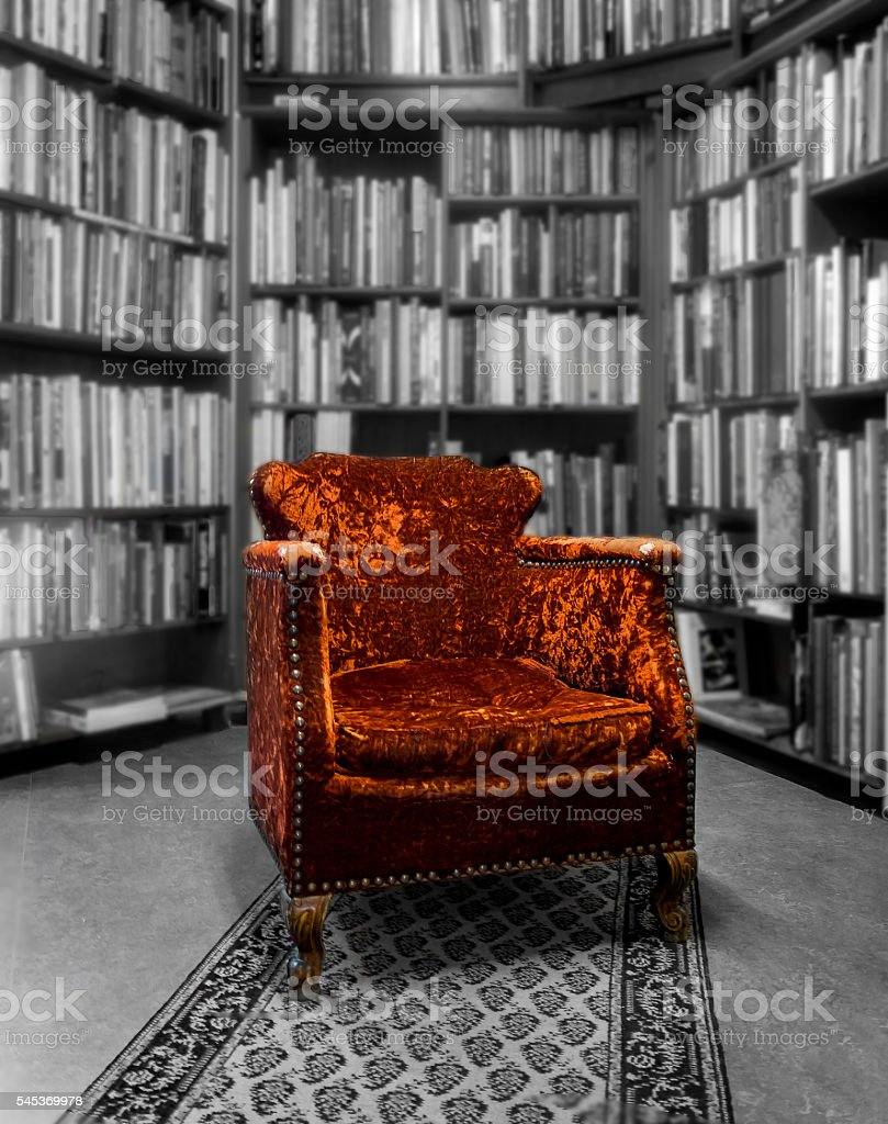 Old armchair in a library stock photo