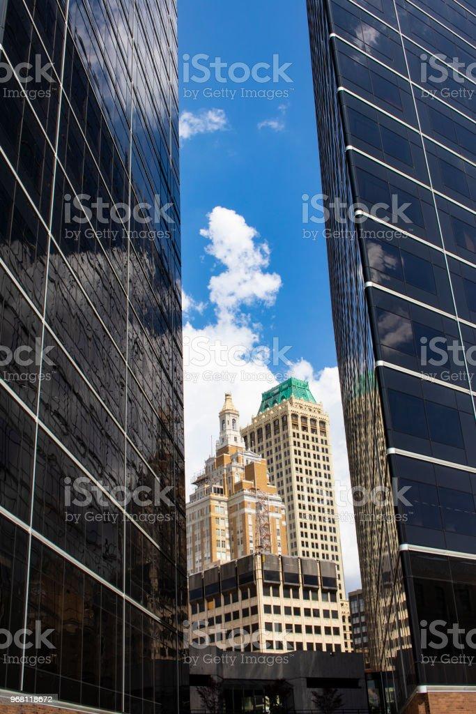 Old Art Deco Buildings Viewed Between Two Ultra Modern Buildings