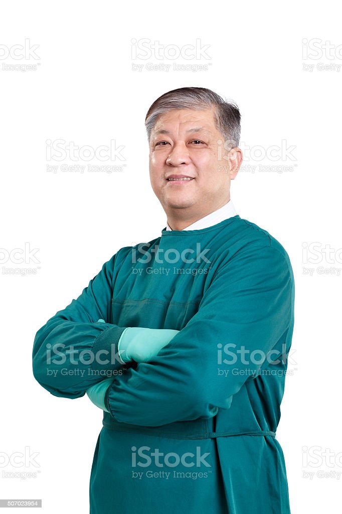 old asian man doctor in green surgical gown with gloves stock photo