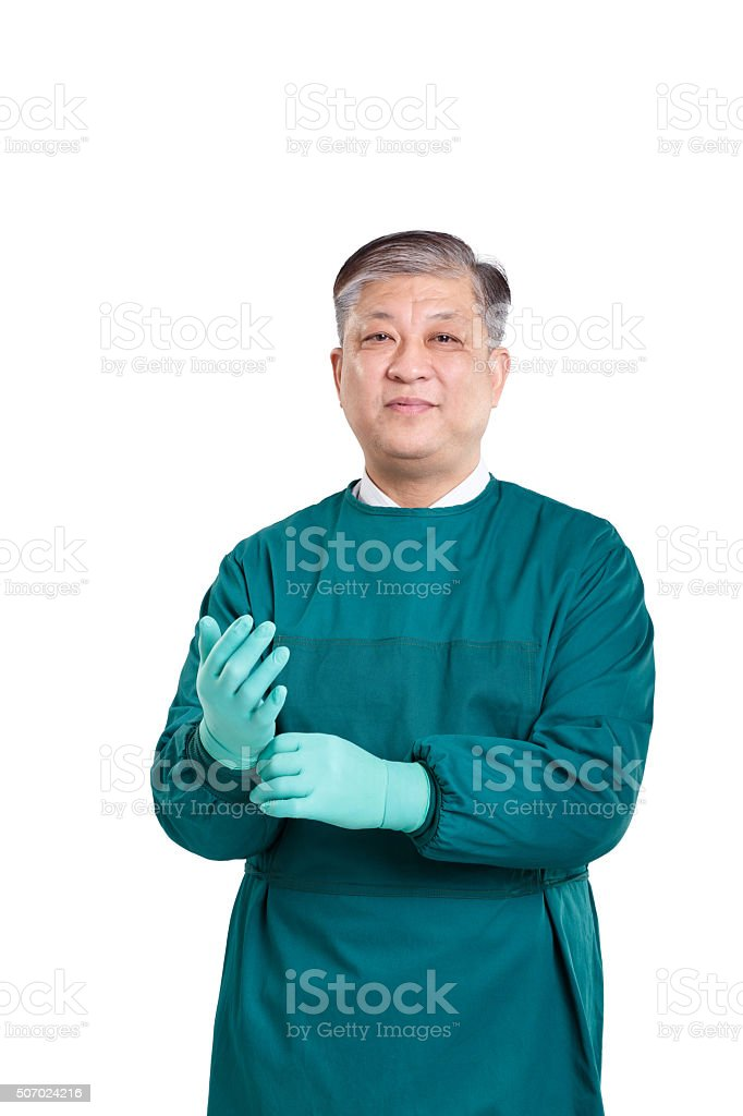 Old Asian Man Doctor In Green Surgical Gown With Gloves Stock Photo ...
