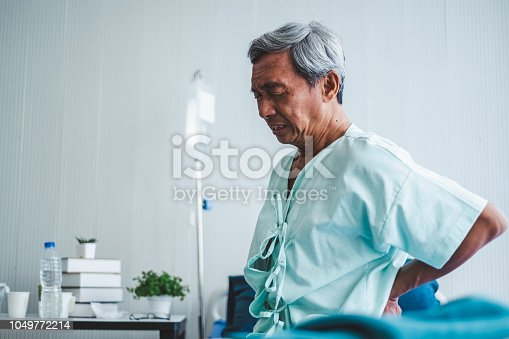 821012164istockphoto Old asian patient suffering from back pain, back ache 1049772214