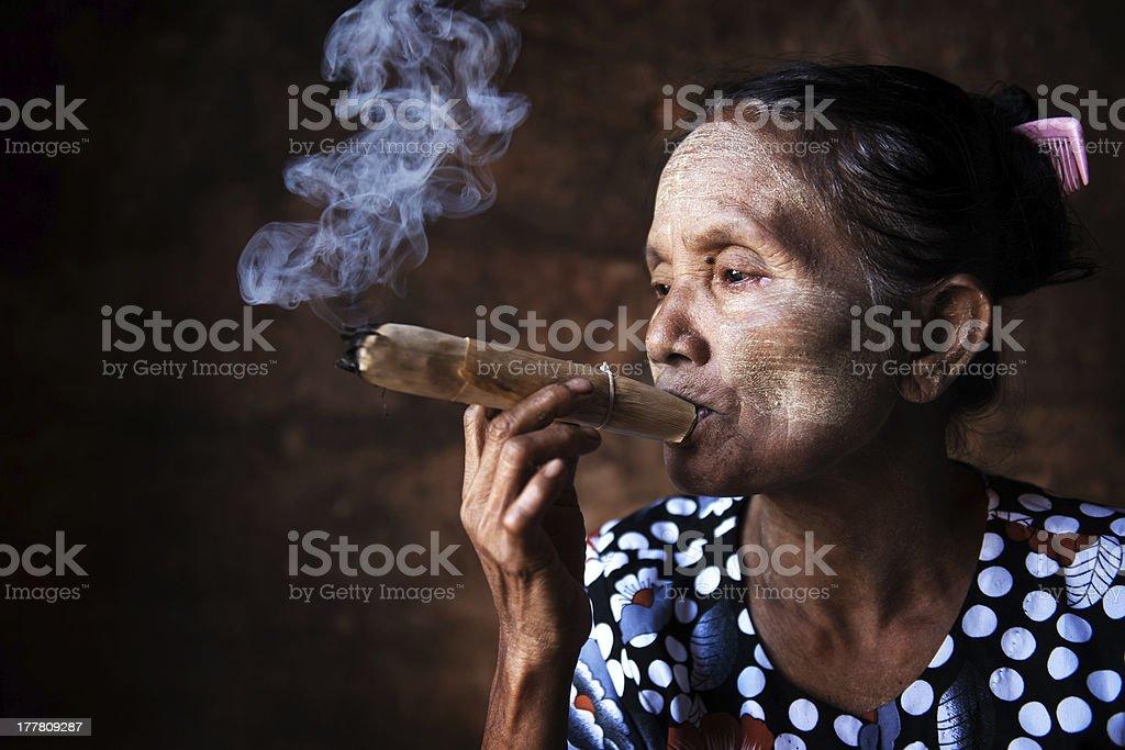 Old Asian woman smoking stock photo
