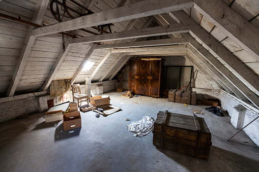 istock Old attic with hidden secrets of an abandoned house 500213514