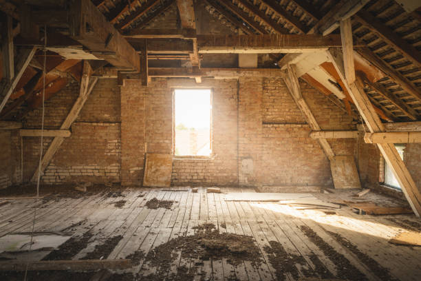Old attic with sunlight coming through window. stock photo