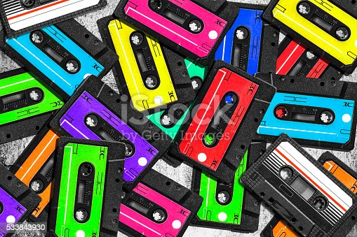 istock Old audio cassette. Multicolored audio tapes. Close-up view. 533843930