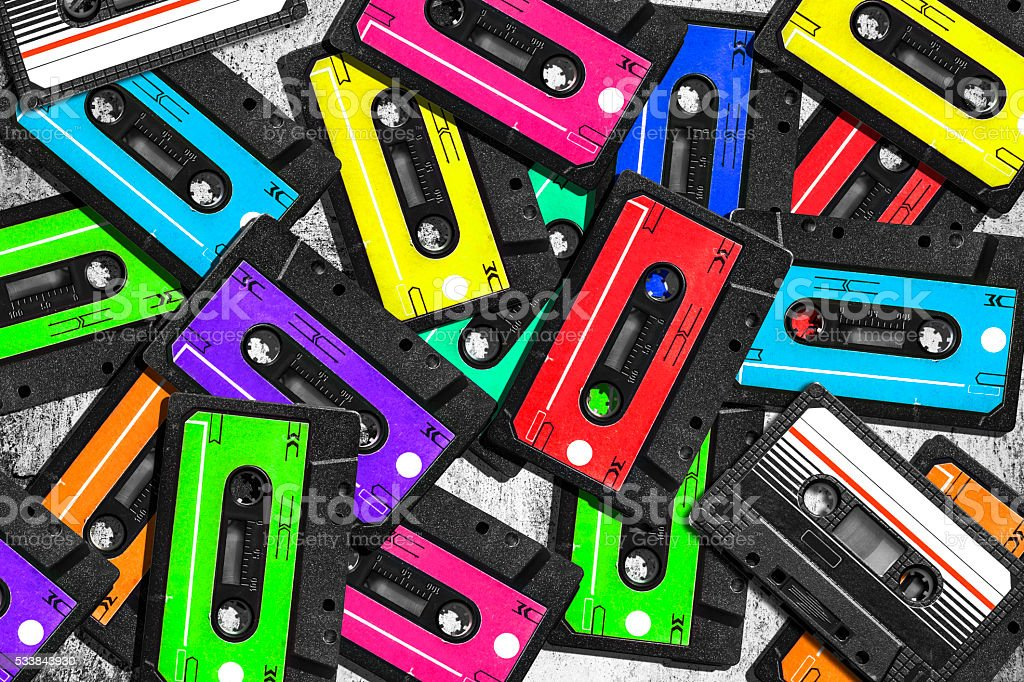 Old audio cassette. Multicolored audio tapes. Close-up view. stock photo