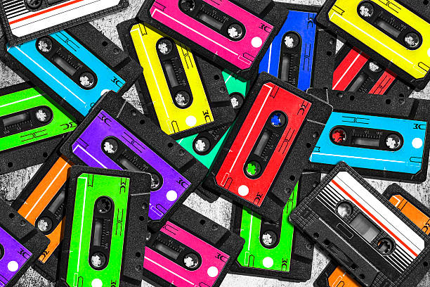 old audio cassette. multicolored audio tapes. close-up view. - 1980s style stock photos and pictures